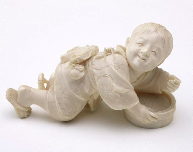 An image of Figure of a boy with a bamboo box (okimono)