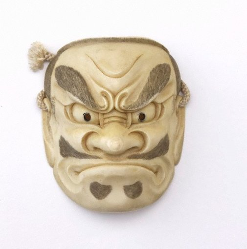 An image of Netsuke in the form of a 'beshimi' ('sorrowful demon') Nō mask by Tomotoshi