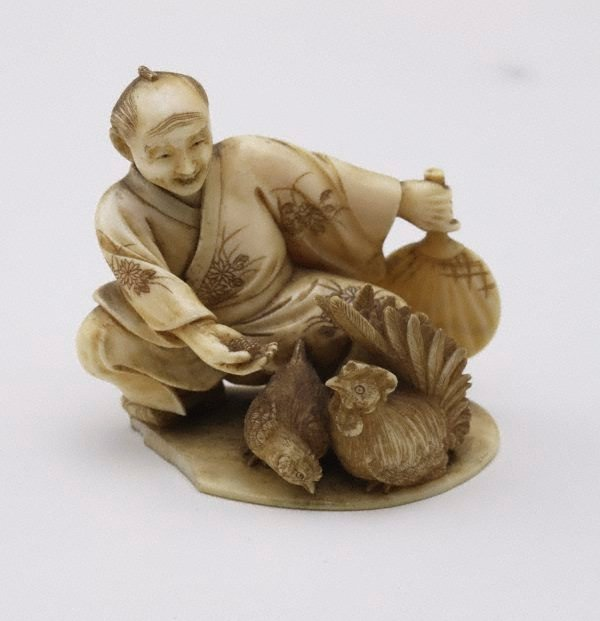 An image of Figure of a man with a hen and a rooster (okimono)