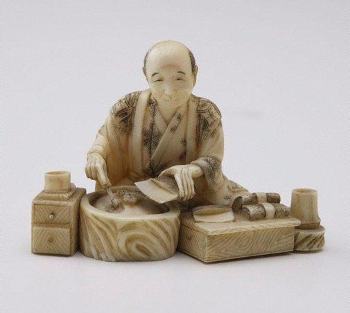 An image of Figure of a man preparing food (okimono) by Shizukuni