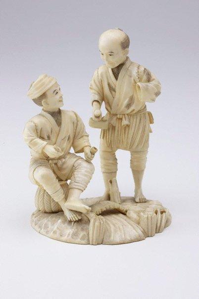 An image of Group of two men at a bridge (okimono) by Gyokuzan