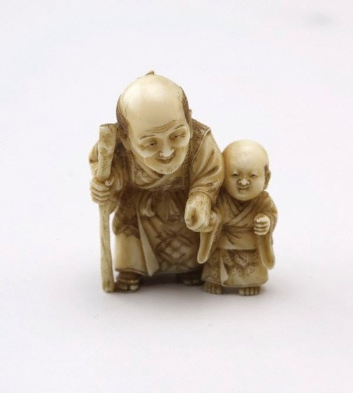 An image of Netsuke in the form of an old man with a boy by Seiko