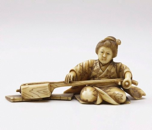 An image of Figure of a seated woman playing shamisen (okimono) by Tamayuki
