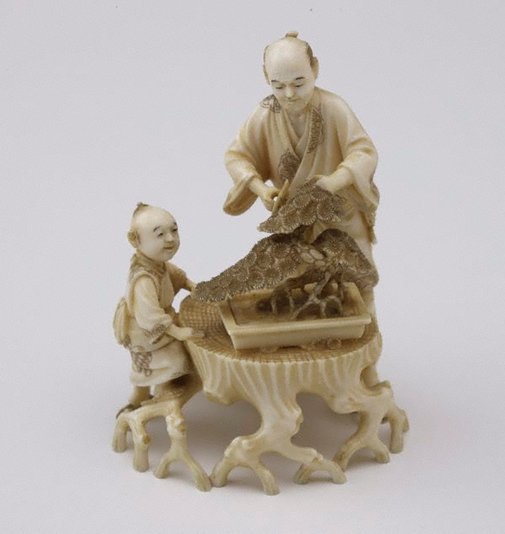 An image of Man trimming bonsai tree and child seated nearby watching (okimono) by Ichimin