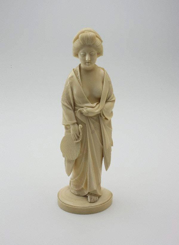 An image of Figure of a woman in a loosely draped kimono (okimono)