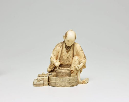 An image of Figure of a seated miller grinding grain (okimono) by Sôya