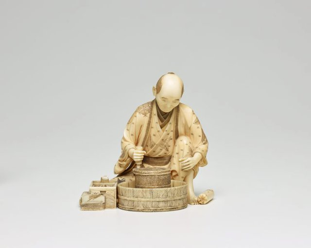 An image of Figure of a seated miller grinding grain (okimono)
