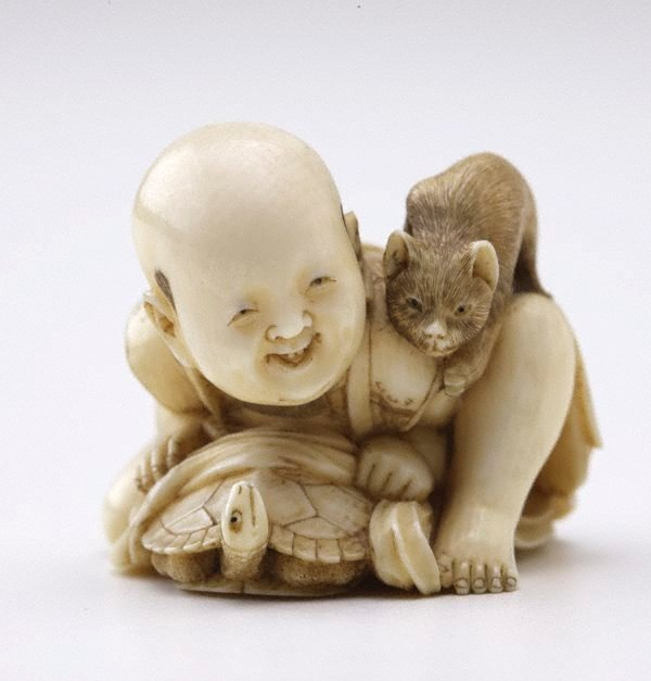 An image of Netsuke in the form of a child with a tortoise and a cat