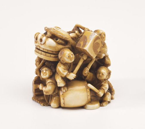 An image of Netsuke in the form of a festival group with a mask, drums and lanterns by Kôgetsu