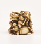Alternate image of Netsuke in the form of a festival group with a mask, drums and lanterns by Kôgetsu