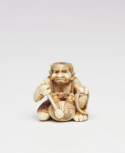 An image of Netsuke in the form of a demon chanting Buddhist sutra by Unknown