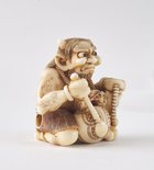 Alternate image of Netsuke in the form of a demon chanting Buddhist sutra by