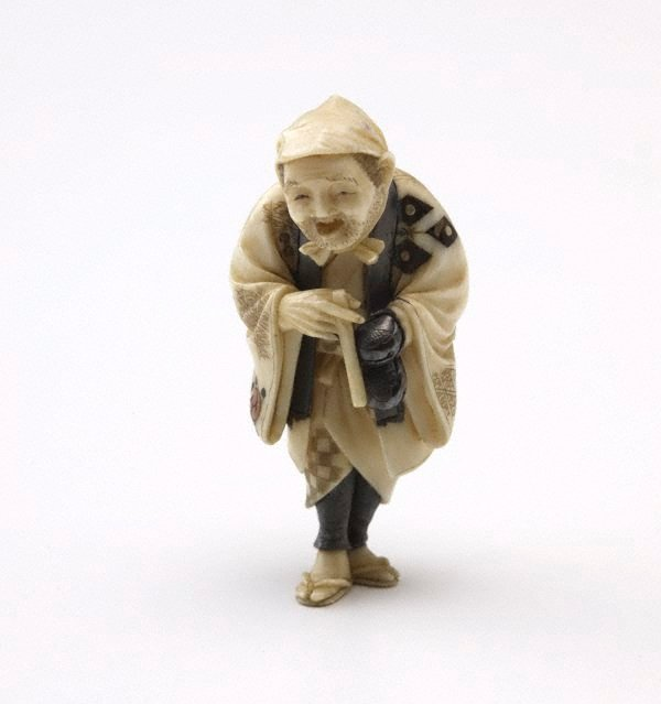 An image of Netsuke in the form of an old man