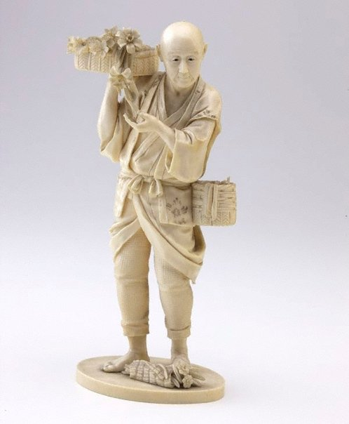 An image of Figure of a man carrying a basket of flowers on his shoulder (okimono) by Unknown