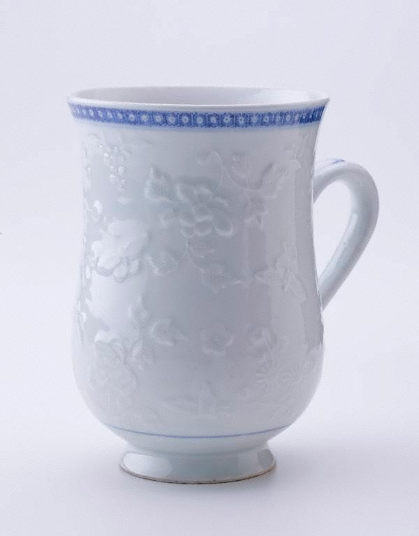 An image of Jug with raised floral and butterfly pattern