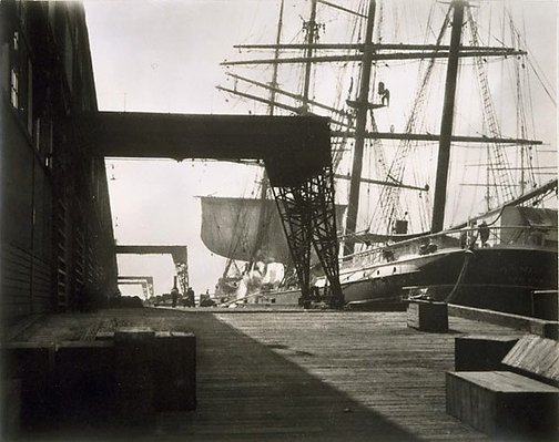 An image of Untitled (wharf with sailing ship) by Harold Cazneaux