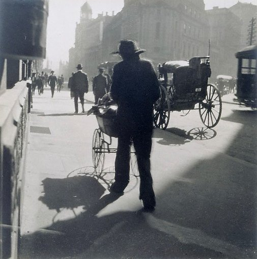 An image of Untitled (man with pram, George Street) by Harold Cazneaux