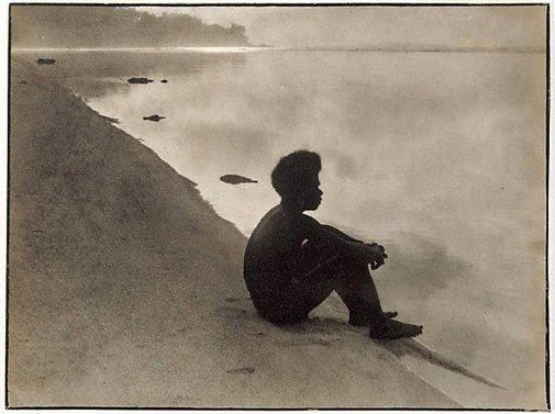 An image of Lad on beach in lagoon, Star Harbour, Solomon Islands by Norman C Deck