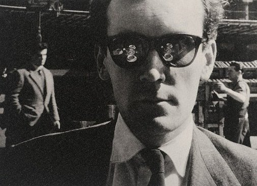 An image of Terence Greer, playwright, outside Gare St Lazare, Paris by Lewis Morley