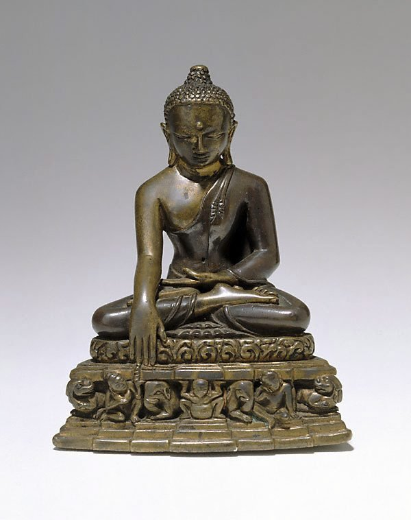 An image of Buddha calling the earth to witness