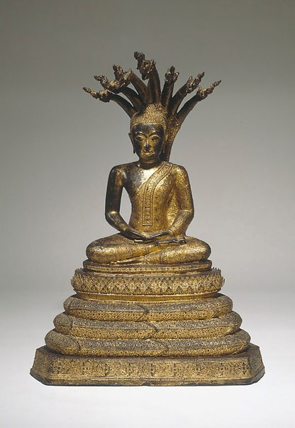 An image of Buddha sheltered by the naga Muchalinda by