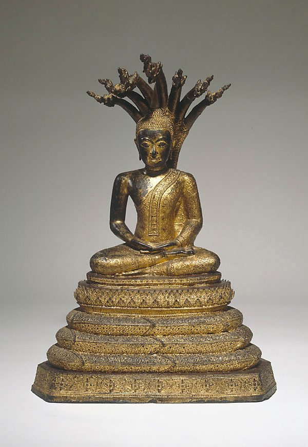 An image of Buddha enthroned under the seven headed naga