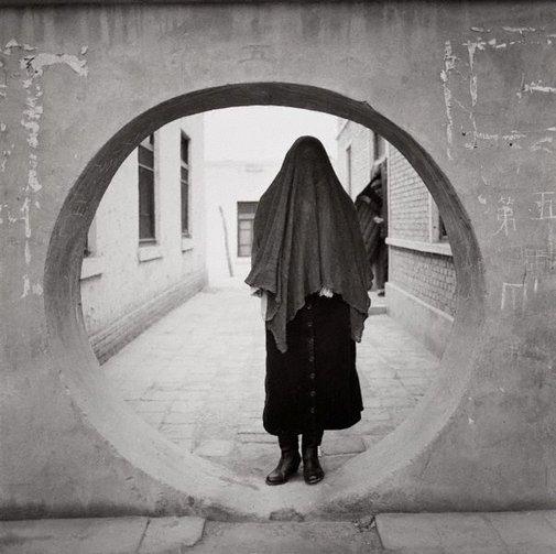 An image of Muslin woman – Kashgar, China by Max Pam