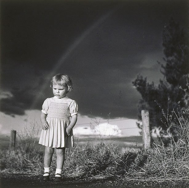 An image of Little girl in a thunderstorm