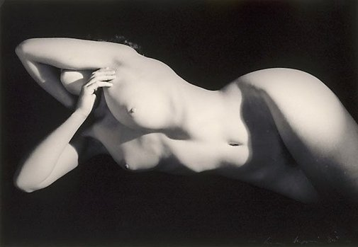 An image of Untitled (Nude horizontal against black) by Max Dupain