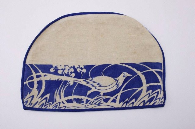 An image of Tea cosy cover with lyrebird design