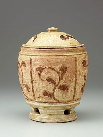 An image of Covered jar by