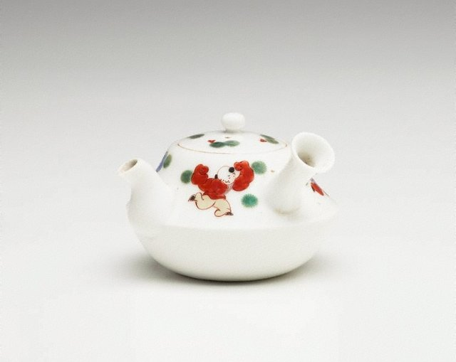 An image of Tea pot for 'sencha' with décor of playing Chinese children and pine leaves