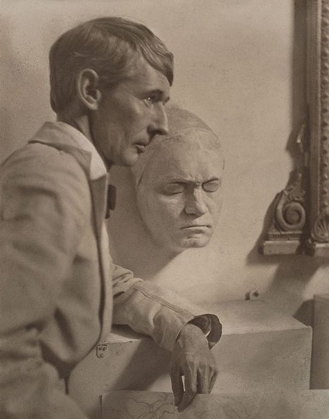 An image of Norman Lindsay with Beethoven's death mask by Harold Cazneaux