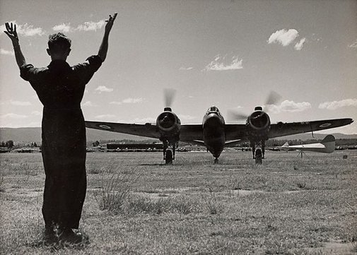 An image of Untitled (airplane on landing field) by Max Dupain