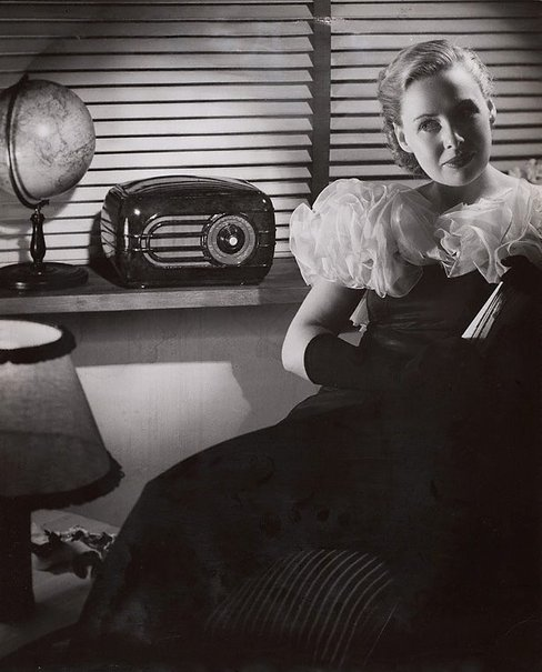 An image of Untitled (woman listening to radio) by Max Dupain