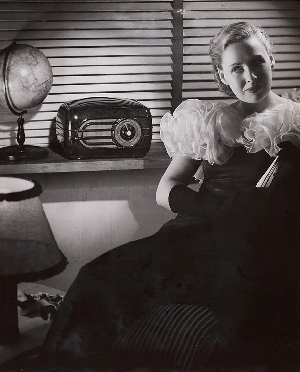An image of Untitled (woman listening to radio)