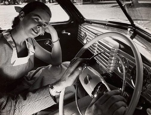 An image of Untitled (woman land car radio) by Max Dupain