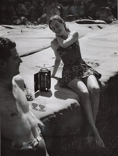 An image of Untitled (bathers and radio) by Max Dupain