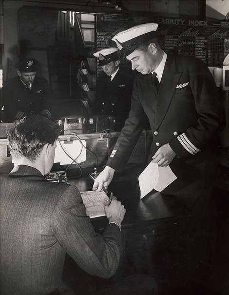An image of Untitled (pilots in office) by Max Dupain