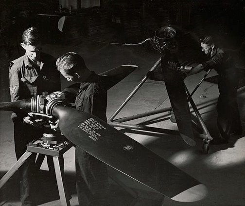An image of Untitled (men and propellers) by Max Dupain