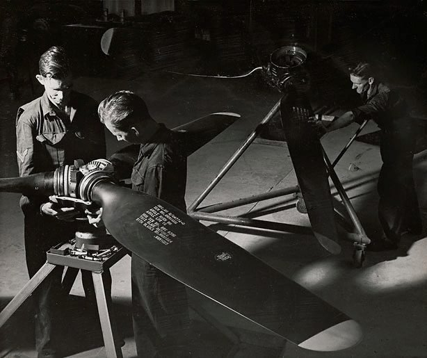 An image of Untitled (men and propellers)