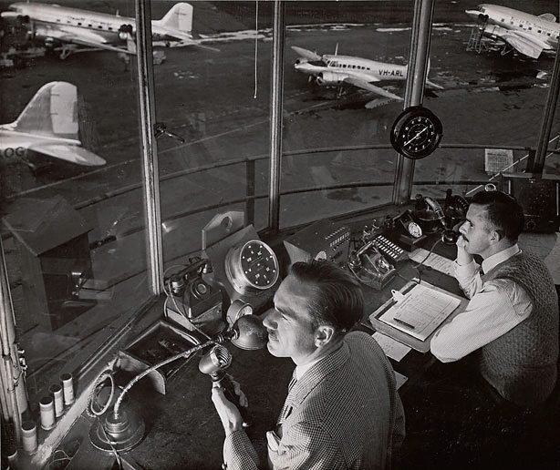 An image of Untitled (men in control tower)