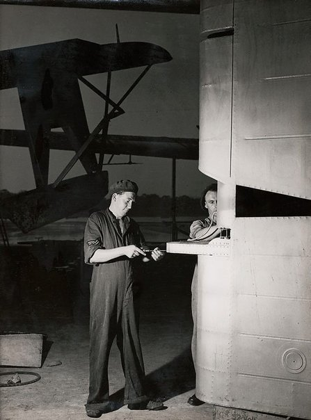 An image of Untitled (men and airplane wing) by Max Dupain