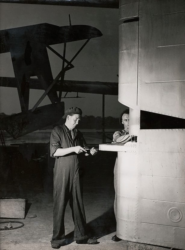 An image of Untitled (men and airplane wing)