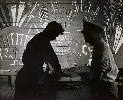 An image of Untitled (men in tool store-room) by Max Dupain