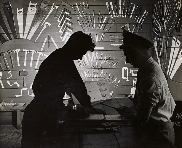 An image of Untitled (men in tool store-room)