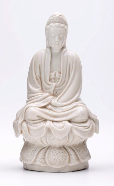 An image of Guanyin, bodhisattva of compassion, seated on a lotus by