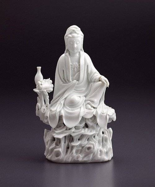 An image of Guanyin with a vase and three scrolls by Dehua ware