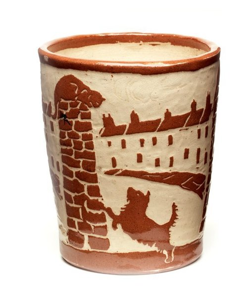 An image of Beaker (with repeating design of a row of terraces, a dog and a cat on a wall) by Gladys Reynell