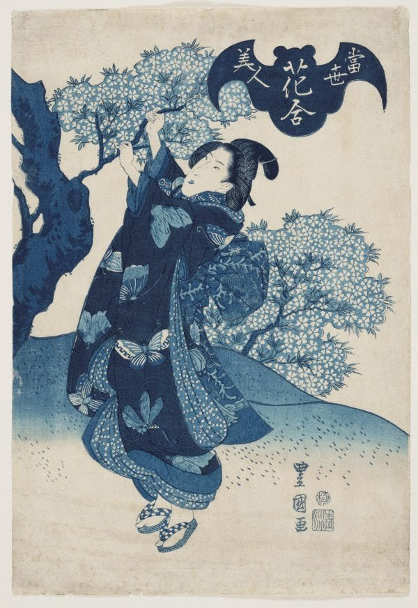 An image of Woman with cherry blossoms